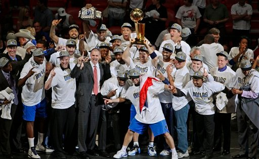 The Dallas Mavericks celebrate after Game 6 of the NBA Finals basketball game against the Miami Heat Sunday, June 12, 2011, in Miami.
