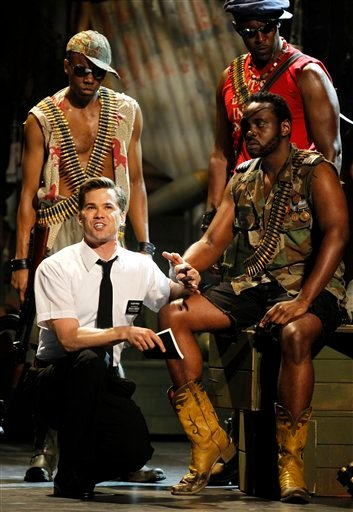 "Andrew Rannells, left, and the cast of ""The Book of Mormon"" perform during the 65th annual Tony Awards, Sunday, June 12, 2011 in New York. (AP Photo/Jeff Christensen)"