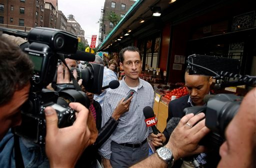 Rep. Anthony Weiner, D-N.Y., is questioned by the media near his home in the Queens borough of New York, Saturday, June 11, 2011.