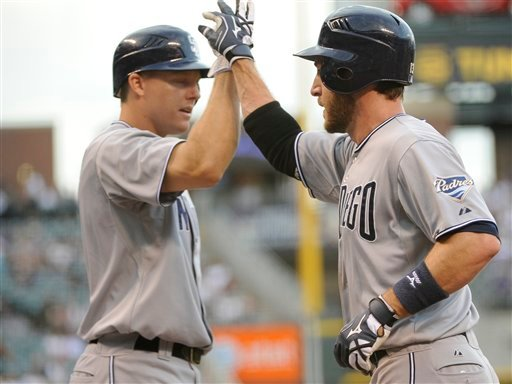 San Diego Padres' Chris Denorfia, right, is congratulated by teammate Nick Hundley after Denorfia scored during the first inning of a baseball game against the Colorado Rockies Monday, June 13, 2011, in Denver. (AP Photo/Jack Dempsey)