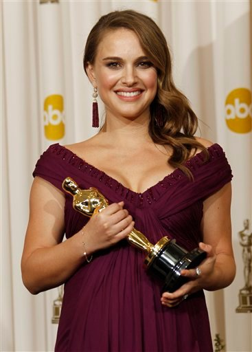 """FILE - In this Feb .27, 2011 file photo, Natalie Portman poses backstage with the Oscar for best performance by an actress in a leading role for """"Black Swan"""" at the 83rd Academy Awards in the Hollywood section of Los Angeles."""