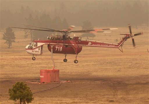 A sky crane fills up with with fire retardant Tuesday, June 14, 2011 near Luna, N.M .and Alpine, Ariz. (AP Photo/Matt York)