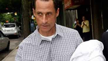 In this June 11, 2011 file photo, Rep. Anthony Weiner, D-N.Y., carries his laundry to a laundromat near his home in the Queens borough of New York June 11, 2011. (AP Photo/David Karp, File)
