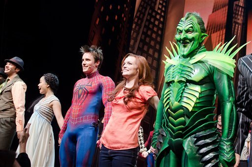 "Patrick Page, right, Jennifer Damiano and Reeve Carney appear onstage at the curtain call for the opening night performance of the Broadway musical ""Spider-Man: Turn Off the Dark"" in New York."