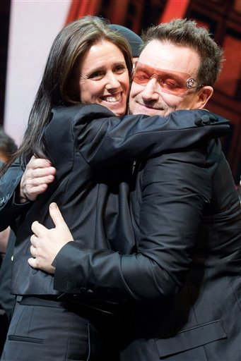 "Julie Taymor and Bono appear onstage at the curtain call for the opening night performance of the Broadway musical ""Spider-Man: Turn Off the Dark""."