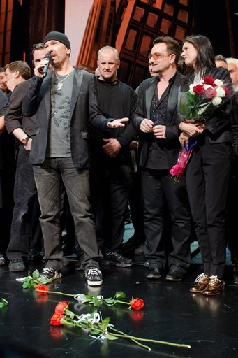 """Julie Taymor, right, Bono and The Edge appear onstage at the curtain call for the opening night performance of the Broadway musical """"Spider-Man Turn Off the Dark""""."""