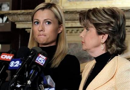 Former porn actress Ginger Lee, left, and her attorney Gloria Allred address a news conference at the Friars Club, in New York, Wednesday, June 15, 2011. (AP Photo/Richard Drew)