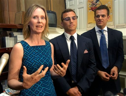 Actress Cynthia Nixon, New York Rangers' Sean Avery, center, and Brian Ellner from Campaign for New York Marriage, right, talk with reporters after asking lawmakers to pass legislation to legalize same-sex marriage June 14, 2011. (AP Photo/Hans Pennink)