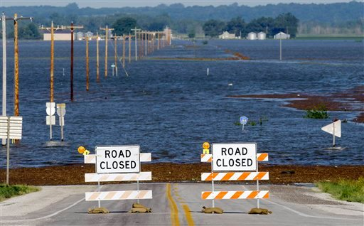 Flood waters from the nearby Missouri River cover a county highway, Wednesday, June 15, 2011, in Hamburg, Iowa. The water level continues to rise and officials say that it should crest sometime later this week. (AP Photo/Charlie Neibergall)