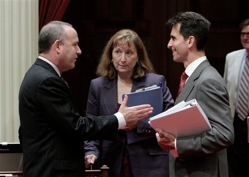 State Senate President Pro Tem Darrell Steinberg, D-Sacramento, left, talks Sen. Ellen Corbett, D-San Leandro and Senate budget committee chair Mark Leno, D-San Francisco, after the Senate session at the Capitol June 13, 2011. (AP Photo/Rich Pedroncelli)