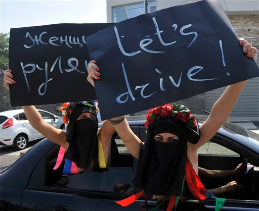 Semi naked activists from the Ukrainian female rights group Femen protest in front of the Saudi Arabian embassy against a ban on driving cars for women in Kiev, Ukraine, Thursday, June 16, 2011. (AP Photo/Sergei Chuzavkov)