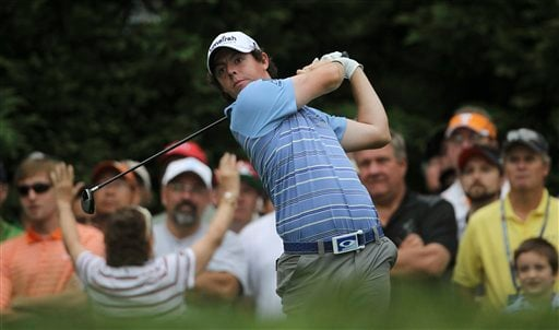 Rory McIlroy, of Northern Ireland, watches his drive from the fifth tee during the second round of the U.S. Open Championship golf tournament in Bethesda, Md., Friday, June 17, 2011. (AP Photo/Mike Groll)
