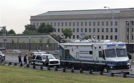 Law enforcement work near the Pentagon after a suspicious vehicle forced multiple road closures Friday, June 17, 2011 in Arlington, Va. (AP Photo/Alex Brandon)