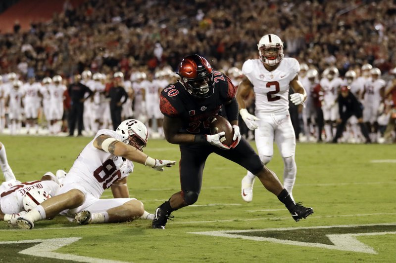 San Diego State running back Rashaad Penny scores a touchdown during the first half of an NCAA college football game against Stanford on Saturday, Sept. 16, 2017, in San Diego.