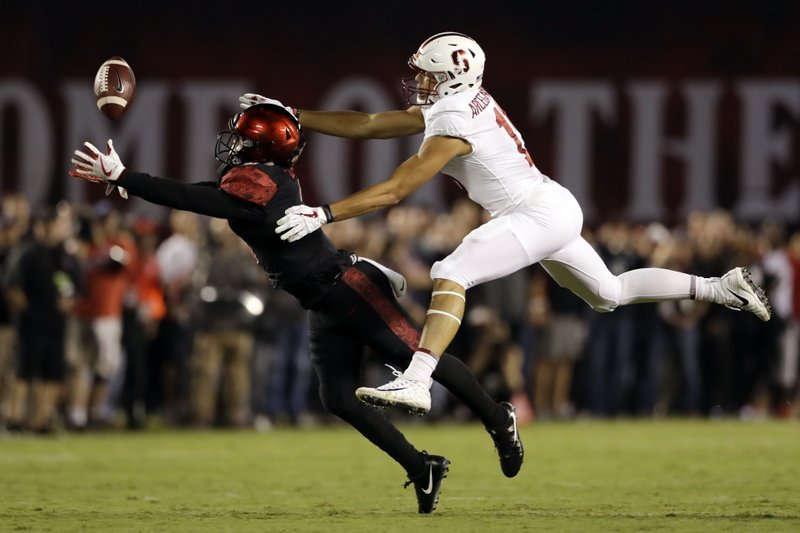 San Diego State safety Trey Lomax, left, can't quite reach a pass intended for Stanford wide receiver JJ Arcega-Whiteside during the first half of an NCAA college football game Saturday, Sept. 16, 2017, in San Diego.