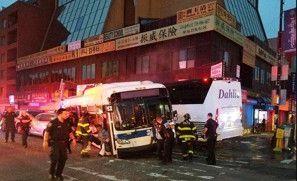 NYPD's 109th Precinct, officers respond to a collision involving two buses on Main Street in the Queens borough of New York.