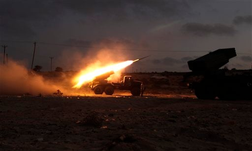 Rebel fighters fire a Grad rocket at the front line west of Misrata, Libya, Monday, June 20, 2011.