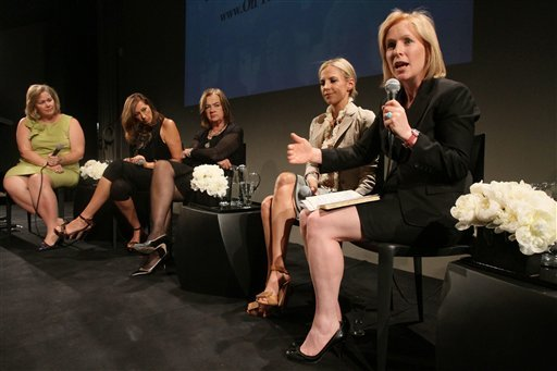 """In this June 2, 2011 photo, Sen. Kirsten Gillibrand, D-N.Y., right, speaks, as Kiki McLean, left, Donna Karan, second from left, Judy McGrath, center, and Tory Burch listen during a """"Getting Women off the Sidelines"""" event."""