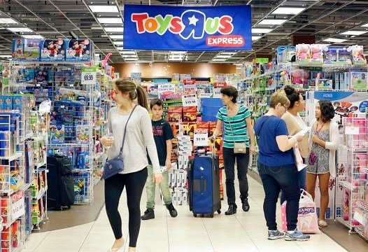 Shoppers shop in a Toys R Us store on Black Friday in Miami.