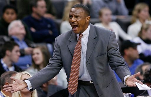FILE - This Dec. 27, 2010, file photo shows Dallas Mavericks assistant coach Dwane Casey yelling to his team during an NBA basketball game against the Oklahoma City Thunder, in Oklahoma City.