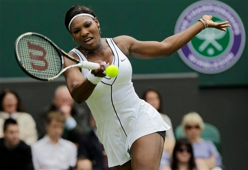 Serena Williams of the US returns a shot to France's Aravane Rezai at the All England Lawn Tennis Championships at Wimbledon, Tuesday, June 21, 2011.