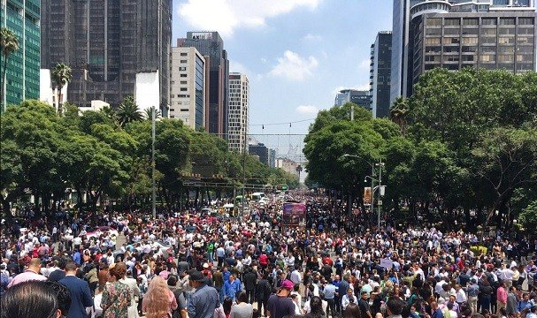 People fill Paseo de la Reforma after evacuating from their offices after an earthquake in Mexico City, Tuesday, Sept. 19, 2017.