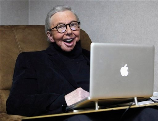 FILE - In this Jan. 12, 2011, file photo, movie critic Roger Ebert works in his office at the WTTW-TV studios in Chicago.
