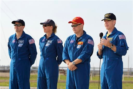 The crew of space shuttle Atlantis, from left, mission specialist Rex Walhiem, mission specialist Sandy Magnus, pilot Doug Hurley and commander Chris Ferguson attend a news conference at Kennedy Space Center.