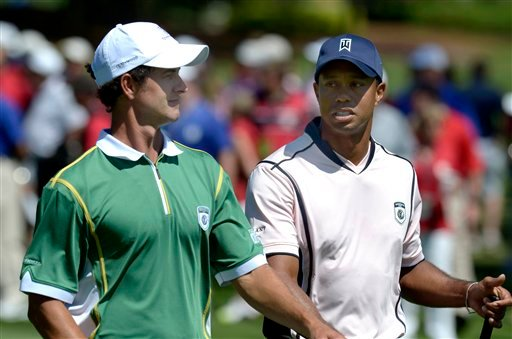 FILE - In this March 14, 2011, file photo, Adam Scott, left, of Australia, chats with Tiger Woods while walking on the ninth fairway during the first day of the Tavistock Cup golf tournament in Windermere, Fla.