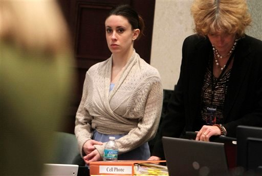 Casey Anthony, left, with her attorney Dorothy Clay Sims, right, stand as the jury enters after lunch during her trial at the Orange County Courthouse in Orlando, Fla., Tuesday, June 21, 2011.