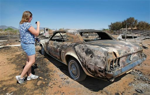 Stephanie Jaco looks over her Mustang that was destroyed along with her home from the Monument Fire near Sierra Vista, Ariz. on Wednesday, June 22, 2011.