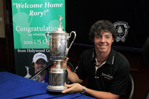 Newly crowned U.S. Open champion Rory McIlroy holds the trophy at at Holywood golf club, Holywood, Northern Ireland, Wednesday, June 22, 2011.