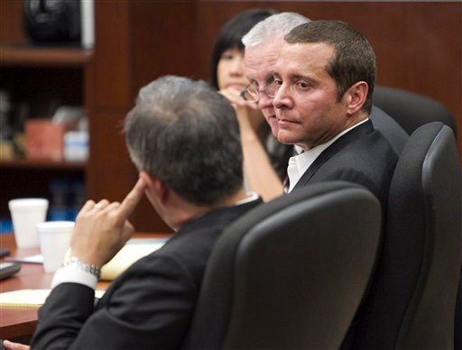 James Arthur Ray, right, and defense attorney Luis Li, left, listen to Yavapai county attorney Sheila Polk give her rebuttal arguments during the trial of James Arthur Ray on Tuesday, June 21, 2011 in Camp Verde, Ariz.