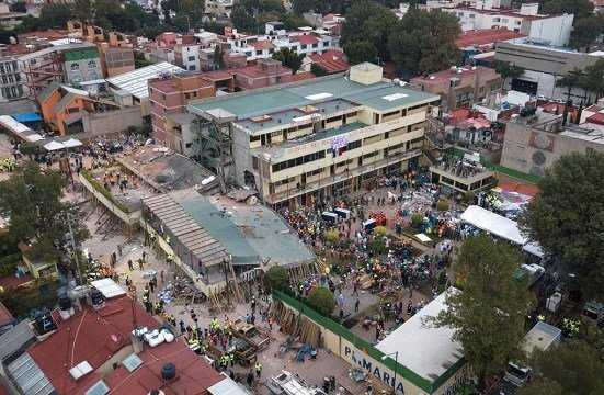 Volunteers and rescue workers search for children trapped inside the Enrique Rebsamen school, collapsed by a 7.1 earthquake in southern Mexico City.