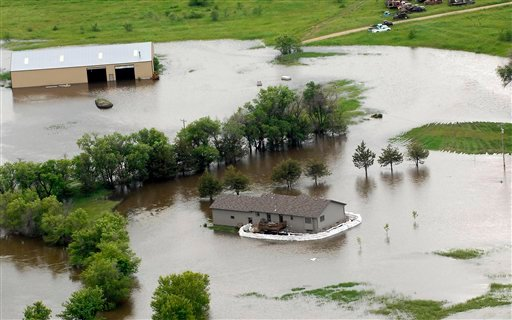 A farm is covered in water near Minot, N.D. on Wednesday, June 22, 2011. (AP Photo/Will Kincaid)