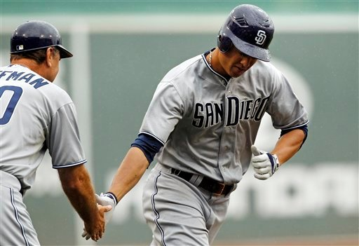 San Diego Padres Will Venable is congratulated by third base coach Trevor Hoffman after his solo home run off Boston Red Sox starter John Lackey in the first inning of an interleague baseball game at Fenway Park June 22, 2011. (AP Photo/Charles Krupa)