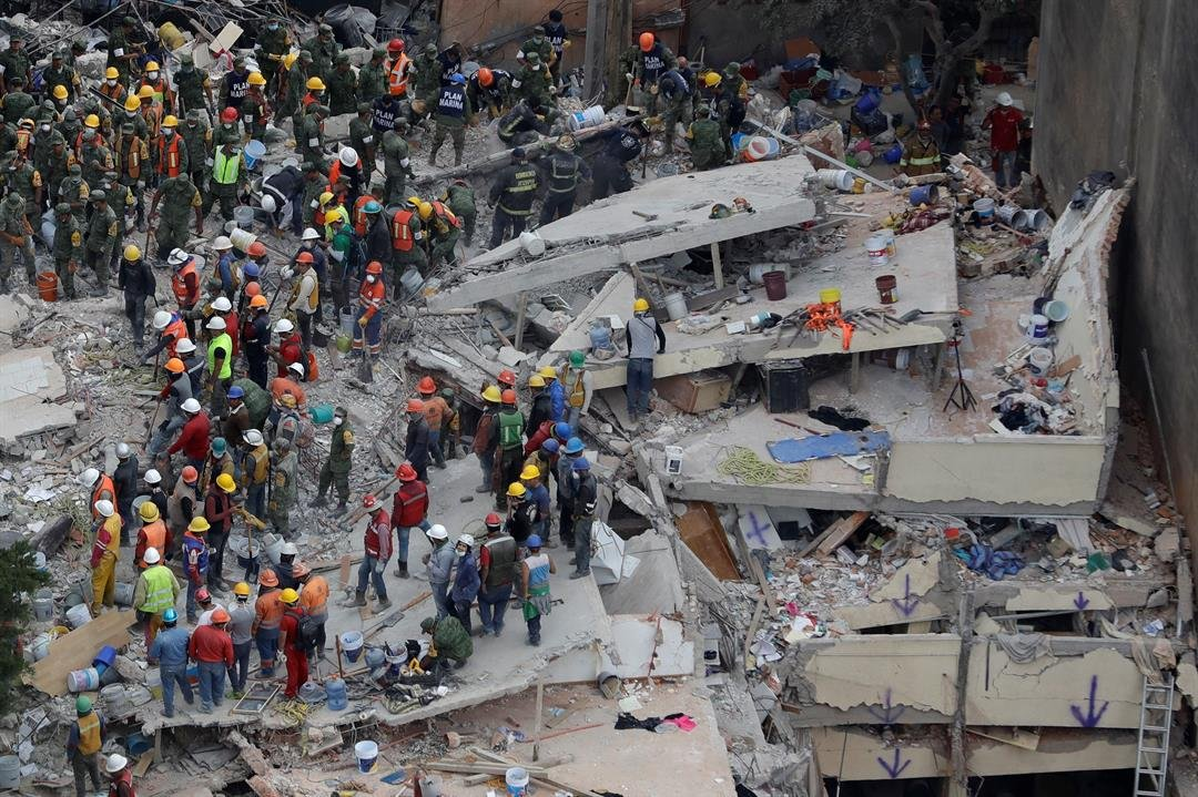 Rescue workers search for people trapped inside a collapsed building in the Del Valle area of Mexico City, Wednesday, Sept. 20, 2017.  (AP Photo/Rebecca Blackwell)