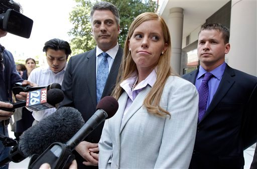 Jamie Leigh Jones, center, pauses before answering a question as her husband, Kallan Daigle, right, and attorney Todd Kelly, stand with her outside the federal courthouse Tuesday, June 14, 2011, in Houston.