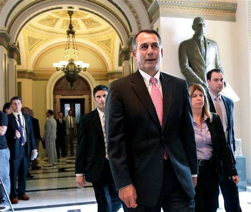 House Speaker John Boehner of Ohio, leaves the House floor on Capitol Hill in Washington, Friday, June 24, 2011, after a vote on funding for U.S. military action in Libya.