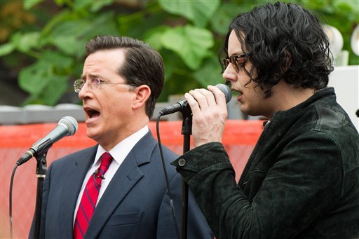 "Stephen Colbert, left, performs a song with Jack White in New York, Friday, June 24, 2011. Colbert debuted his new Jack White-produced single on ""The Colbert Report"" on Thursday night."