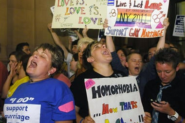 Supporters of gay marriage celebrate after Senate members voted and approved the same-sex marriage bill 33-29 during a session of the New York state Senate at the Capitol in Albany, New York, Friday.