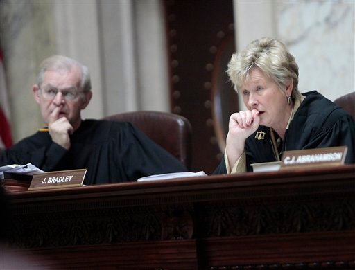 Wisconsin Supreme Court Justices David T. Prosser, Jr. and Ann Walsh Bradley consider oral arguments during a hearing regarding the state's budget bill at the Wisconsin State Capitol, Monday, June 6, 2011. (AP)