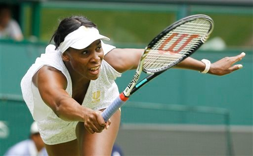 Venus Williams of the US returns a shot to Bulgaria's Tsvetana Pironkova during their match at the All England Lawn Tennis Championships at Wimbledon, Monday, June 27, 2011. (AP Photo/Kirsty Wigglesworth)
