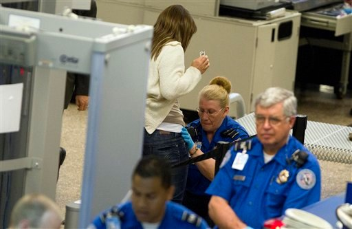 A traveler is patted down by a TSA agent as they go through security at the Salt Lake City International Airport Wednesday, June 1, 2011, in Salt Lake City.