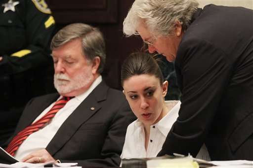 Casey Anthony, center, sits at the defense table with her attorneys Cheney Mason, left, and Anne Finnell, right, before the start of her murder trial at the Orange County Courthouse in Orlando, Fla. on Monday, June 27, 2011.