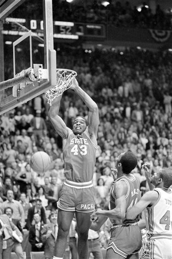 This April 4, 1983 file photo shows North Carolina State's Lorenzo Charles (43) dunking the ball in the basket to give N.C. State a 54-52 win over Houston in the NCAA Championship game in Albuquerque, N.M.