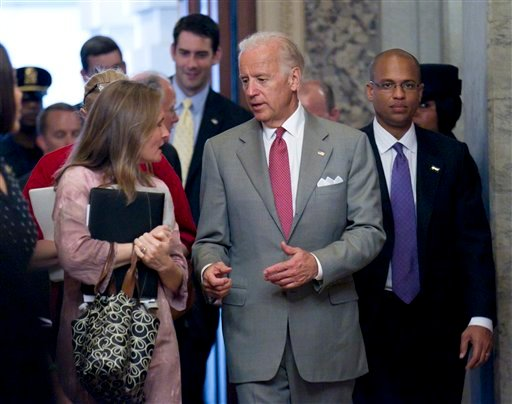 FILE - In this Thursday, June 16, 2011 file picture, Vice President Joe Biden returns to the Capitol for a third day of negotiations between Republicans and Democrats in Congress on how to solve America's debt crisis and budget problems, in Washington.