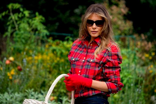 irst lady Melania Trump participates in an harvesting and planting event with the Boys and Girls Club of Washington in the White House Kitchen Garden on the South Lawn of the White House, Friday, Sept. 22, 2017, in Washington. (AP Photo/Andrew Harnik)