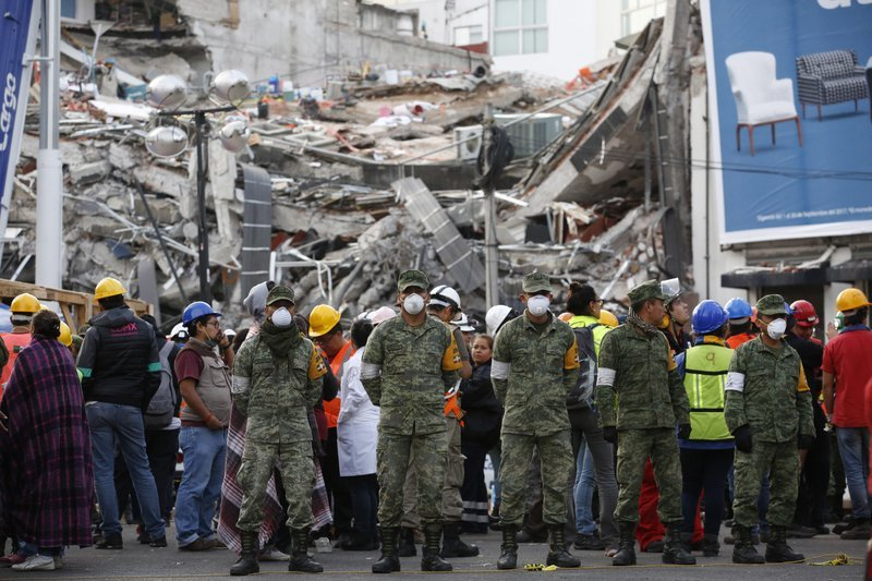 A 7.1 magnitude earthquake Tuesday toppled more than three dozen buildings in the capital, leaving at least 46 people believed missing in this office building alone.(AP Photo/Rebecca Blackwell