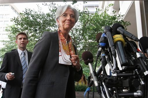 French Finance Minister Christine Lagarde returns to the microphones to give a statement in French outside the International Monetary Fund in Washington, Thursday, June 23, 2011, where she was interviewing to succeed former IMF Managing Director. (AP)